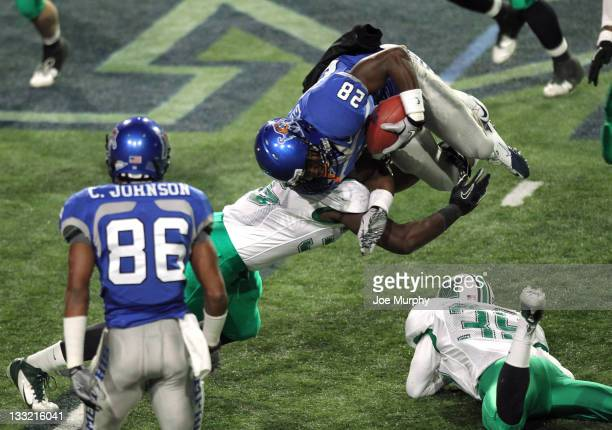 Kellen Harris of the Marshall Thundering Herd tackles Artaves Gibson of the Memphis Tigers on November 17, 2011 at Liberty Bowl Memorial Stadium in...