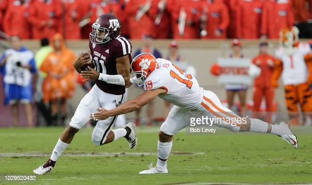 Kellen Mond of the Texas AM Aggies is tackled by Tanner Muse of the Clemson Tigers as he rushes in the first quarter at Kyle Field on September 8...