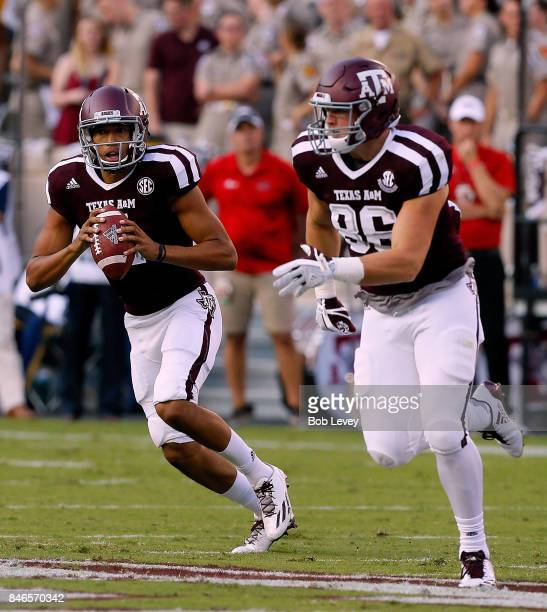 Kellen Mond of the Texas AM Aggies rollout looking for Tanner Schorp against the Nicholls State Colonels at Kyle Field on September 9 2017 in College...