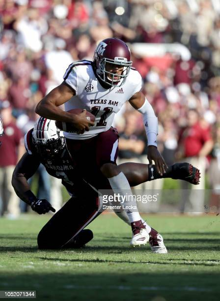 Kellen Mond of the Texas AM Aggies runs past Javon Kinlaw of the South Carolina Gamecocks during their game at WilliamsBrice Stadium on October 13...