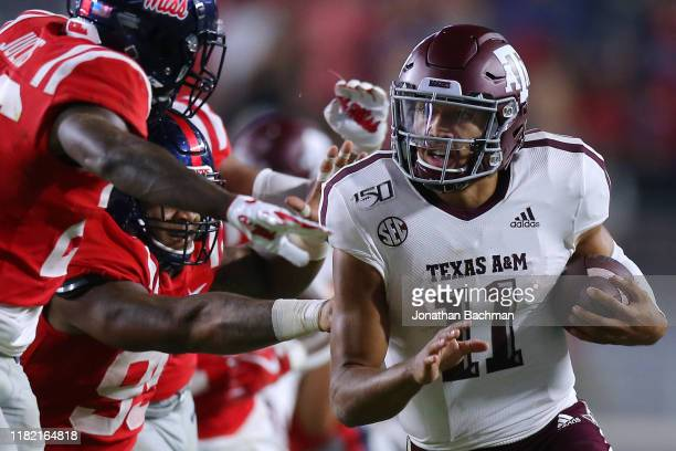 Kellen Mond of the Texas AM Aggies runs with the ball during the second half against the Mississippi Rebels at VaughtHemingway Stadium on October 19...