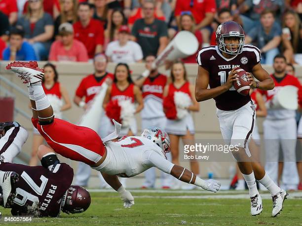 Kellen Mond of the Texas AM Aggies scrambles out of the pocket to avoid a tackle by Terrell Encalade of the Nicholls State Colonels in the second...