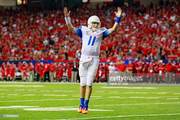 Kellen Moore of the Boise State Broncos reacts after a touchdown against the Georgia Bulldogs at Georgia Dome on September 3, 2011 in Atlanta,...