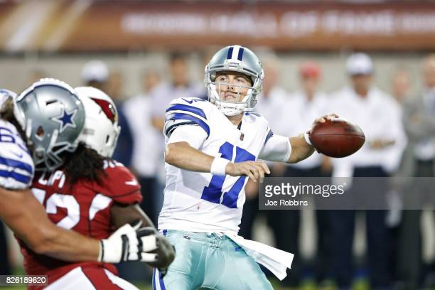 Kellen Moore of the Dallas Cowboys looks to pass in the second quarter of the NFL Hall of Fame preseason game against the Arizona Cardinals at Tom...