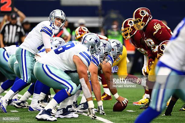 Kellen Moore of the Dallas Cowboys prepares to take the snap against the Washington Redskins during the first half at ATT Stadium on January 3 2016...