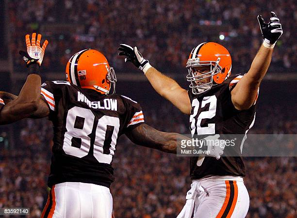 Kellen Winslow of the Cleveland Browns celebrates with Steve Heiden after scoring a touchdown against the Denver Broncos during the first quarter of...