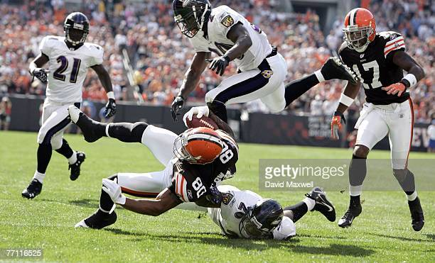 Kellen Winslow of the Cleveland Browns is stopped just short of the goal line by Baltimore Ravens players Ed Reed and Dawan Landry as Chris McAlister...