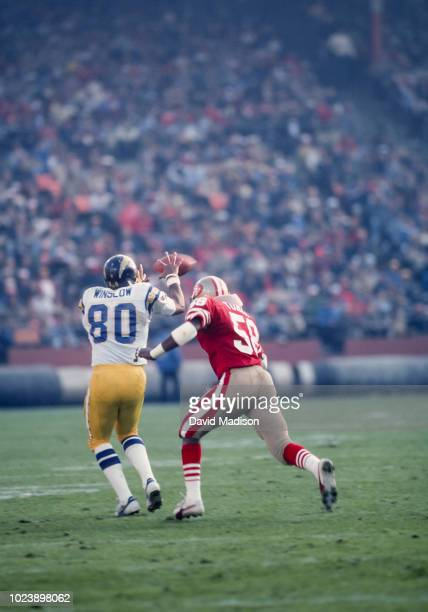 Kellen Winslow of the San Diego Chargers makes a catch while being defended by Keena Turner of the San Francisco 49ers during a National Football...