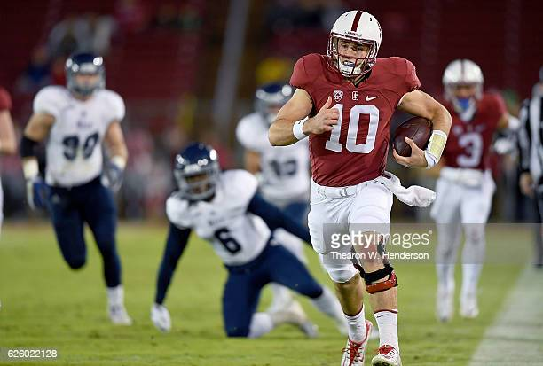 Keller Chryst of the Stanford Cardinal runs up the sidelines for a sixty two yard touchdown run against the Rice Owls in the first quarter of an NCAA...