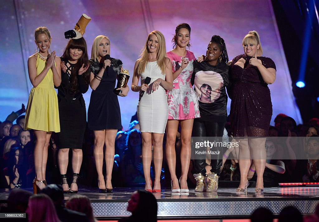 Kelley Jakle, Hana Mae Lee, Brittany Snow, Anna Camp, Ester Dean, and Rebel Wilson accept the award for Best Musical Moment onstage during the 2013 MTV Movie Awards at Sony Pictures Studios on April 14, 2013 in Culver City, California.