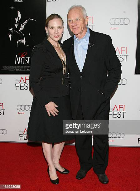 Kelley Kuhr and Malcolm McDowell attends the 2011 AFI FEST The Artist Special Screening at Grauman's Chinese Theatre on November 8 2011 in Hollywood...