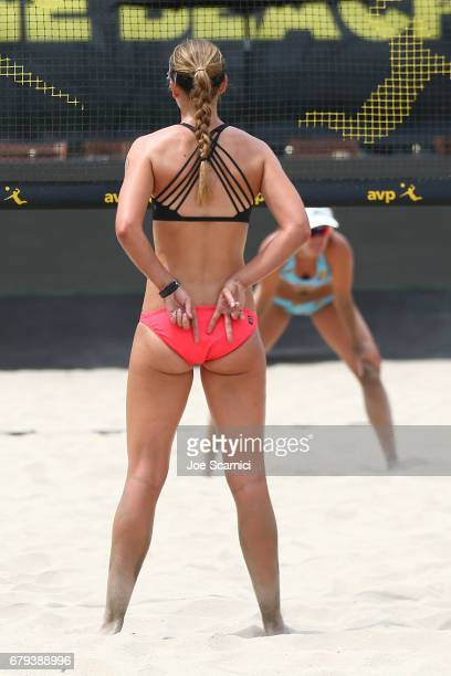 Kelley Larsen sends a signal to Betsi Flint during their match against Geena Urango and Angela Bensend at AVP Huntington Beach Open at the Huntington...