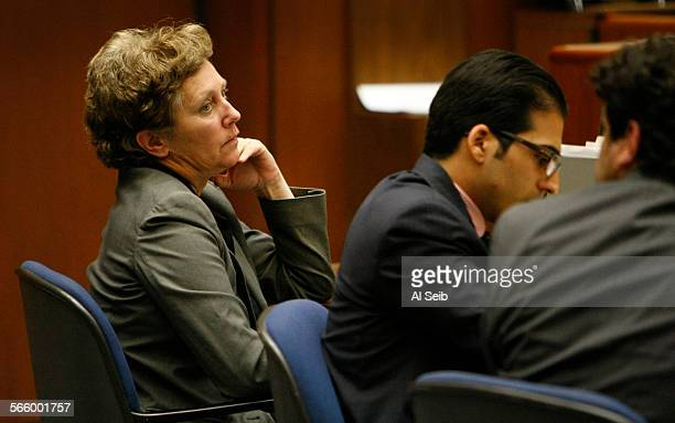 Kelley Lynch left a former business manager for singer and songwriter Leonard Cohen appears in Los Angeles Superior Court with her public defenders...