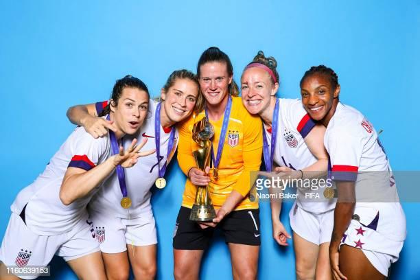 Kelley O'Hara, Allie Long, Alyssa Naeher, Becky Sauerbrunn and Crystal Dunn of the USA pose with the Women's World Cup trophy after the 2019 FIFA...
