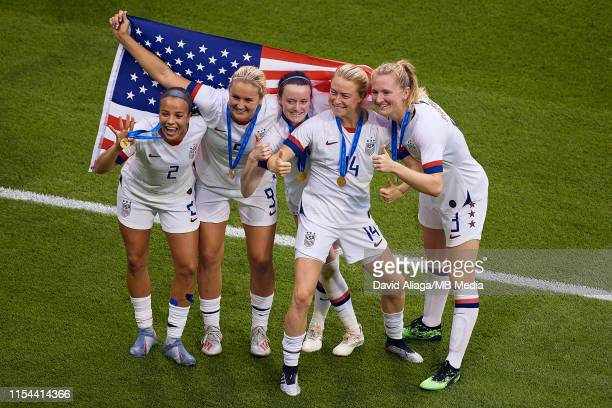 Kelley O'Hara Lindsey Horan Rose Lavelle Emily Sonnett and Samantha Mewis of the USA pose with the USA flag after the victory during the 2019 FIFA...