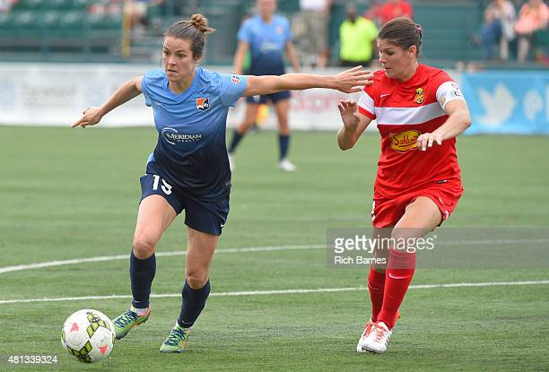 Kelley O'Hara of Sky Blue FC controls the ball against the defense of Brittany Taylor of Western New York Flash during the second half at Sahlen's...