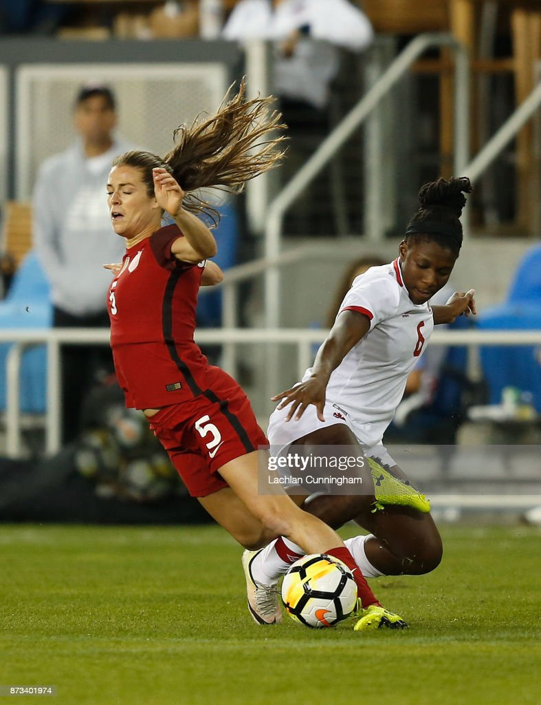 Kelley O'Hara #5 of the United States is tackled by Deanne Rose #6 of Canada during a friendly match at Avaya Stadium on November 12, 2017 in San Jose, California.