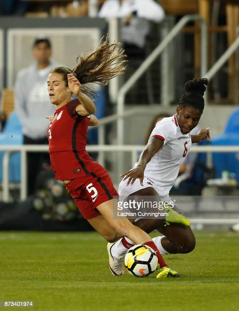 Kelley O'Hara of the United States is tackled by Deanne Rose of Canada during a friendly match at Avaya Stadium on November 12 2017 in San Jose...