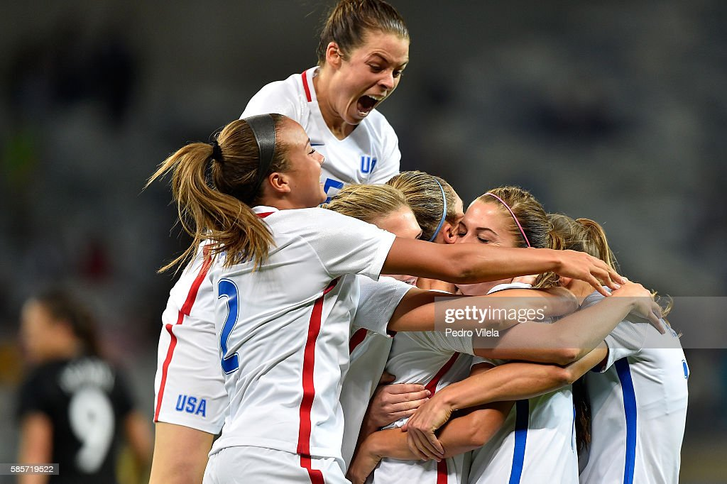Kelley O'Hara #5 of the United States jumps in celebration with Alex Morgan #13 after Morgan scores in the Women's Group G first round match between the United States and New Zealand during the Rio 2016 Olympic Games at Mineirao Stadium on August 3, 2016 in Belo Horizonte, Brazil.