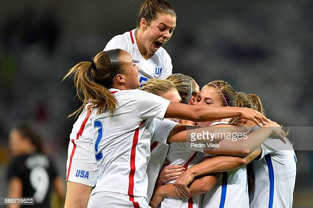 Kelley O'Hara of the United States jumps in celebration with Alex Morgan after Morgan scores in the Women's Group G first round match between the...