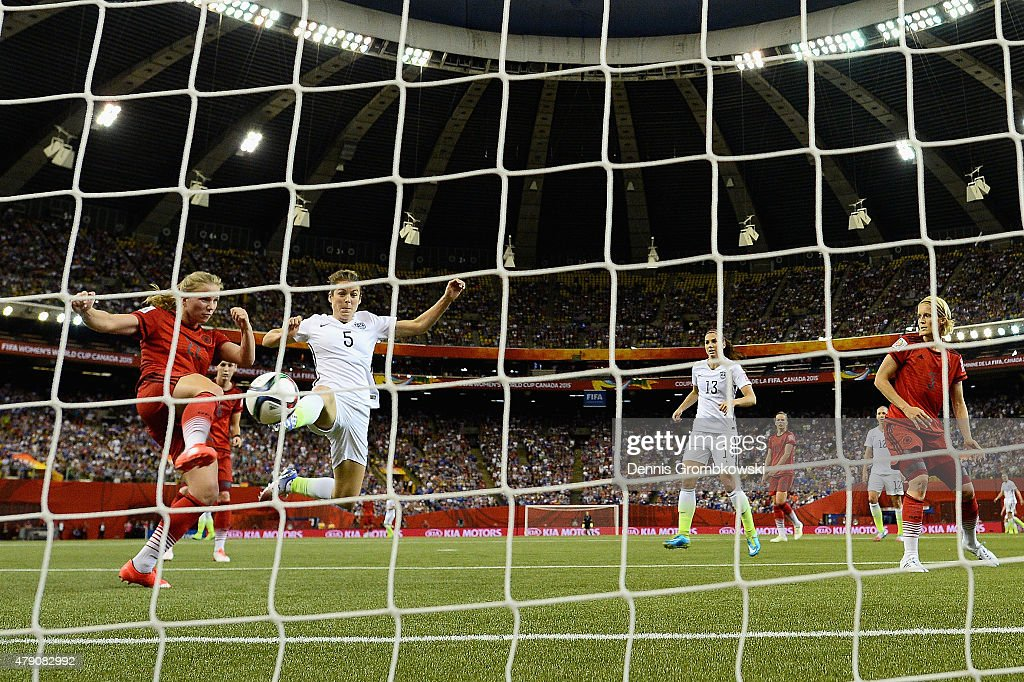 Kelley O'Hara of the United States scores the second goal past Tabea Kemme of Germany in the FIFA Women's World Cup 2015 Semi-Final Match at Olympic Stadium on June 30, 2015 in Montreal, Canada.