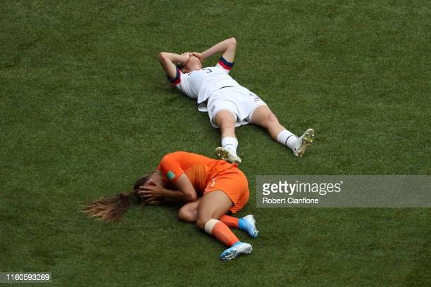 Kelley O'hara of the USA and Lieke Martens of the Netherlands lie on the pitch injured following a clash during the 2019 FIFA Women's World Cup...
