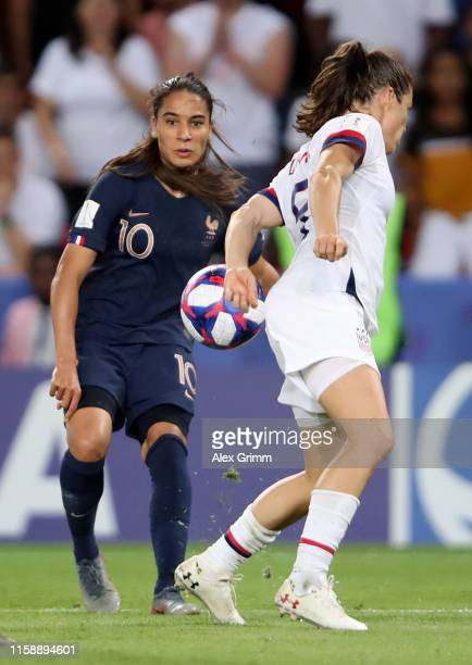 Kelley O'hara of the USA blocks a cross from Amel Majri of France during the 2019 FIFA Women's World Cup France Quarter Final match between France...