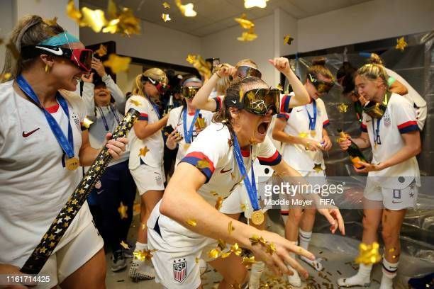 Kelley O'Hara of the USA celebrates with teammates in the locker room after the 2019 FIFA Women's World Cup France Final match between The United...