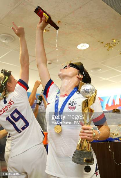 Kelley O'hara of the USA celebrates with the FIFA Women's World Cup Trophy in the dressing room following her team's victory in the 2019 FIFA Women's...