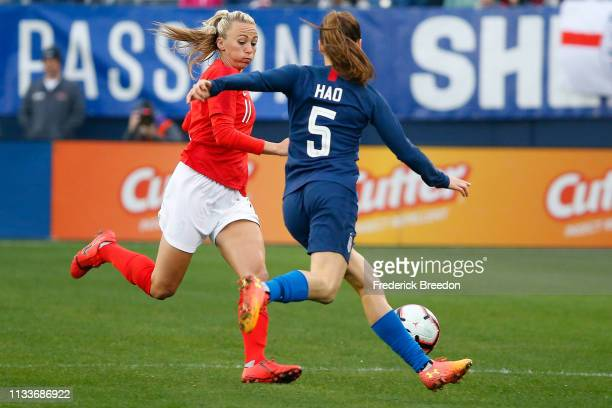 Kelley O'Hara of the USA plays against Toni Duggan of England during the second half of the 2019 SheBelieves Cup match between USA and England at...