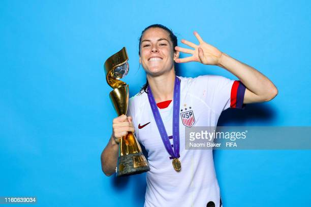 Kelley O'Hara of the USA poses with the Women's World Cup trophy after the 2019 FIFA Women's World Cup France Final match between The United State of...
