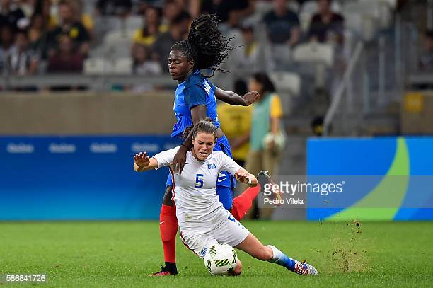 Kelley O'Hara of United States and Griedge Mbock Bathy of France battle for the ball during the Women's Group G first round match between United...