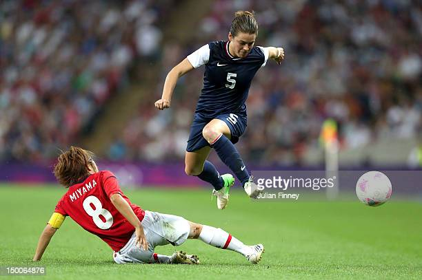 Kelley O'Hara of United States moves the ball against Aya Miyama of Japan in the second half during the Women's Football gold medal match on Day 13...