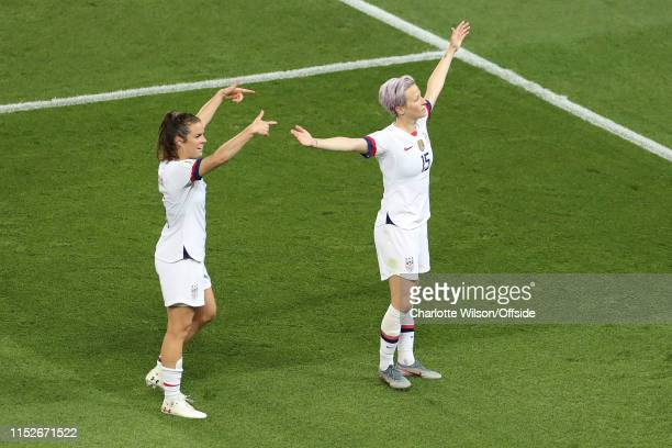 Kelley O'Hara of USA points to Megan Rapinoe as she celebrates scoring their 2nd goal during the 2019 FIFA Women's World Cup France Quarter Final...
