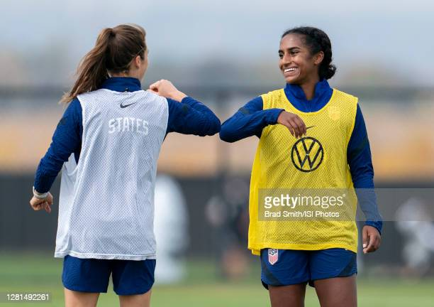 Kelley Ou2019Hara and Naomi of the USWNT bump elbows during a training session at Dick's Sporting Goods Park training fields on October 20 2020 in...
