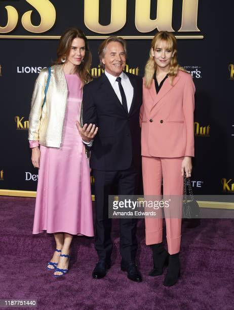 Kelley Phleger Don Johnson and Grace Johnson arrive at the premiere of Lionsgate's Knives Out at the Regency Village Theatre on November 14 2019 in...