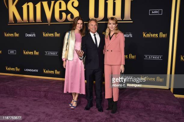 Kelley Phleger Don Johnson and Grace Johnson attend the premiere of Lionsgate's Knives Out at Regency Village Theatre on November 14 2019 in Westwood...
