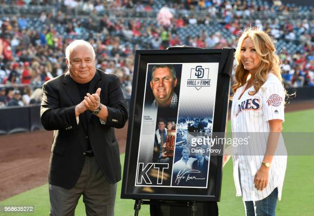 Kelley Towers wife of former San Diego Padres general manager Kevin Towers stands with Ron Fowler Padres' executive chairman in a pregame tribute to...