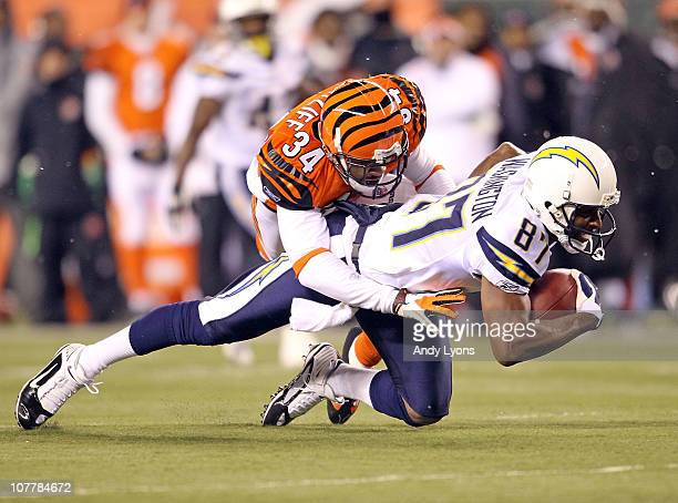 Kelley Washington of the San Diego Chargers runs with the ball while defended by Keiwan Ratliff of the Cincinnati Bengals in the NFL game at Paul...