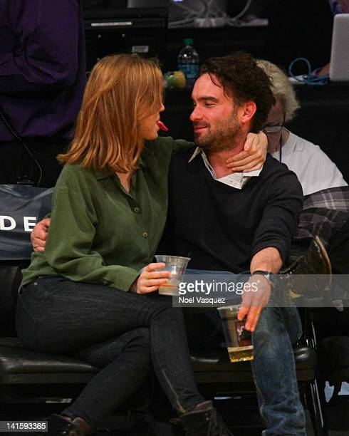 Kelli Garner and Johnny Galecki attend a basketball game between the Utah Jazz and the Los Angeles Lakers at Staples Center on March 18 2012 in Los...
