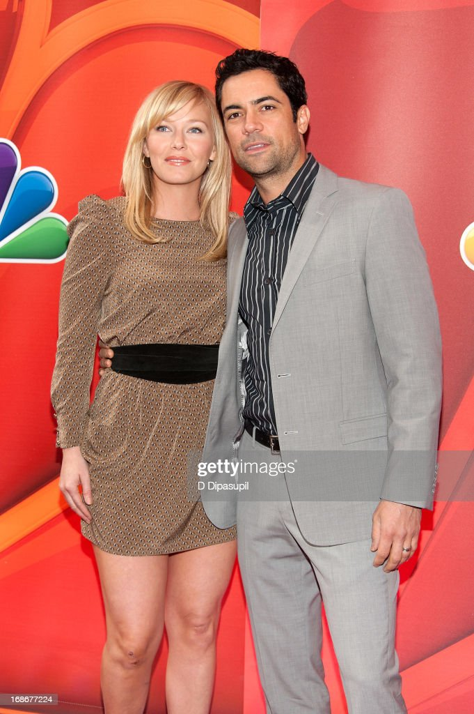 Kelli Giddish (L) and Danny Pino attend the 2013 NBC Upfront Presentation Red Carpet Event at Radio City Music Hall on May 13, 2013 in New York City.
