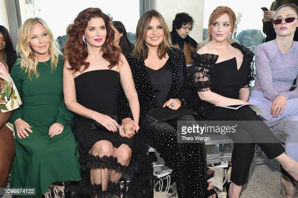 Kelli Giddish, Debra Messing, Mariska Hargitay, Christina Hendricks, and Coco Rocha attend the Christian Siriano front row during New York Fashion...