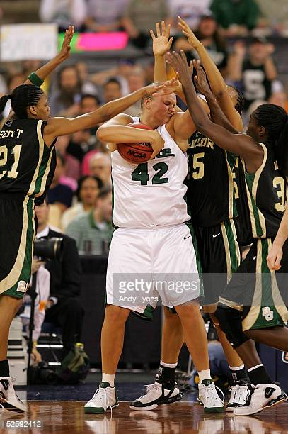 Kelli Roehrig of the Michigan State Spartans comes under pressure from Chameka Scott Steffanie Blackmon and Abiola Wabara of the Baylor Lady Bears in...