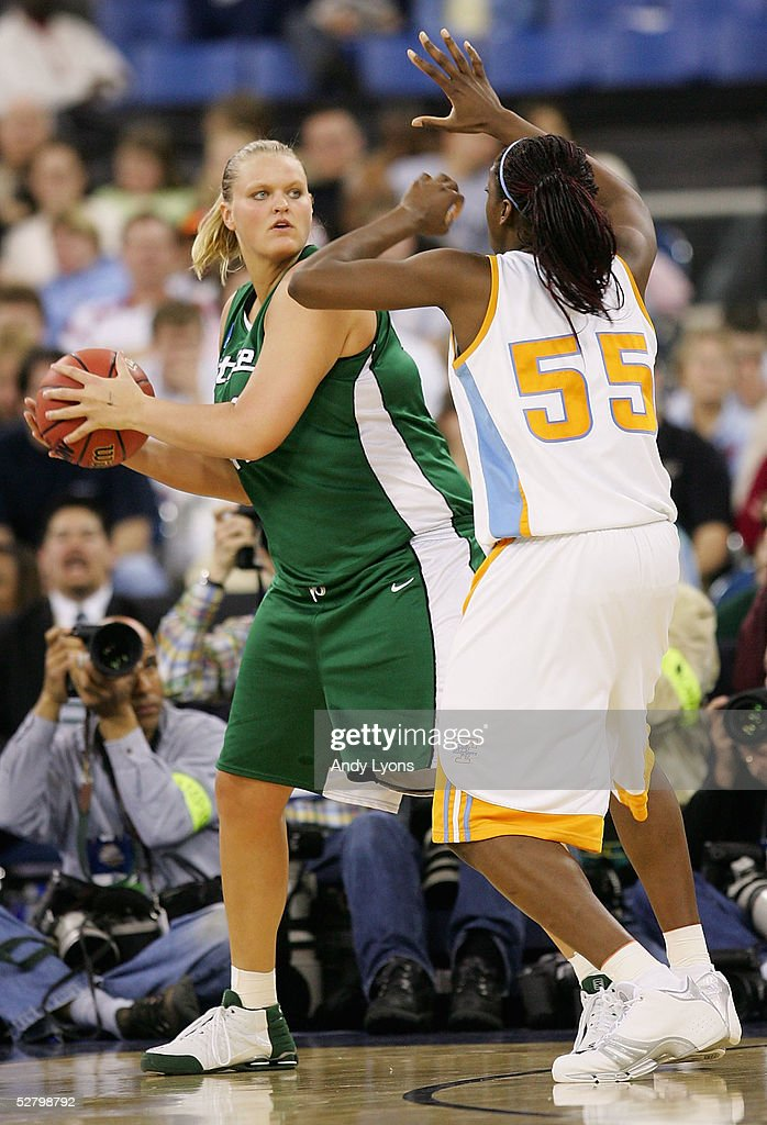 Kelli Roehrig #42 of the Michigan State Spartans looks to pass around Nicky Anosike #55 of the Tennessee Lady Vols in the Semifinal game of the Women's NCAA Basketball Championship on April 3, 2005 at the RCA Dome in Indianapolis, Indiana. Michigan State defeated Tennessee 68-64.