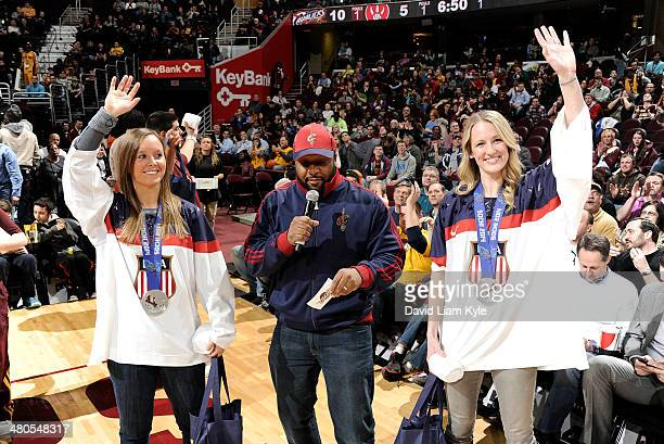 Kelli Stack and Brianne McLaughlin of the US Olympic Women's Team acknowledge the fans during a break in the action of the game between the Cleveland...