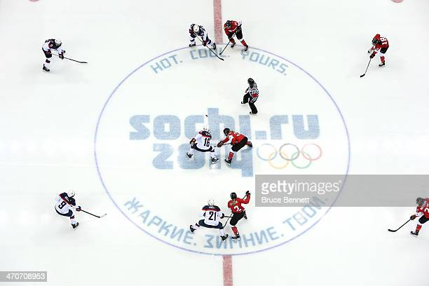 Kelli Stack of the United States and Hayley Wickenheiser of Canada face off during the Ice Hockey Women's Gold Medal Game on day 13 of the Sochi 2014...