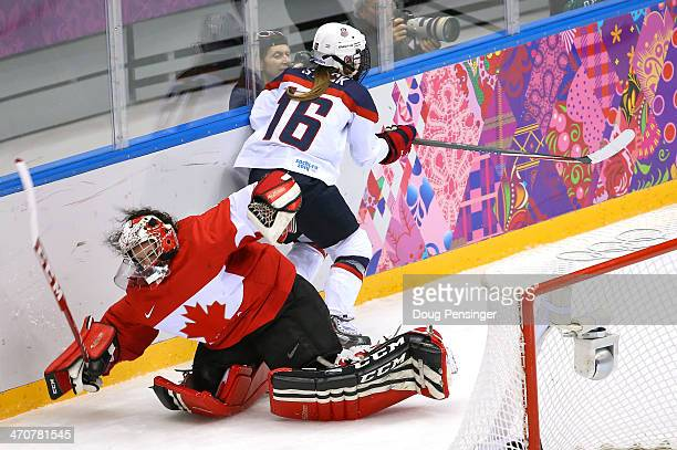 Kelli Stack of United States collides with Shannon Szabados of Canada behind the net during the Ice Hockey Women's Gold Medal Game on day 13 of the...