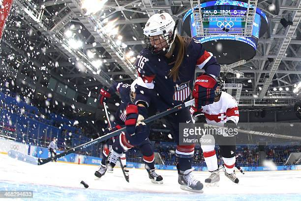 Kelli Stack of United States skates for the puck during the Women's Ice Hockey Preliminary Round Group A game on day three of the Sochi 2014 Winter...