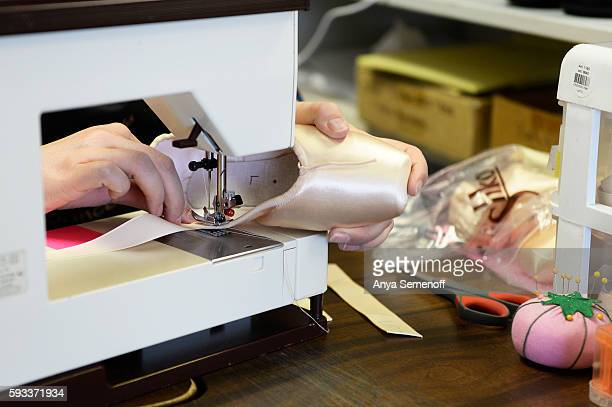 Kellie Amend sews in ribbons to a new pair of pointe shoes at Assemble Dancewear on August 11 in Castle Rock Colorado Noel Amend has been fitting...