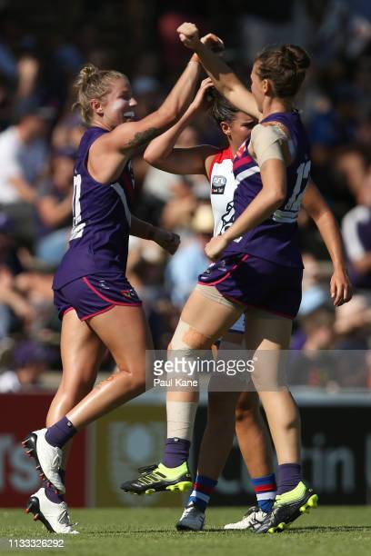 Kellie Gibson and Ebony Antonio of the Dockers celebrate a goal during the round five AFLW match between the Fremantle Dockers and the Western...